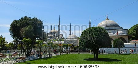 ISTANBUL TURKEY - MAY 20 2016 - Tourists in Blue Mosque in Sultanahmet in Istanbul Turkey. More than 32 million tourists visit Turkey each year. A popular tourist site the Sultan Ahmed Mosque continues to function as a mosque today