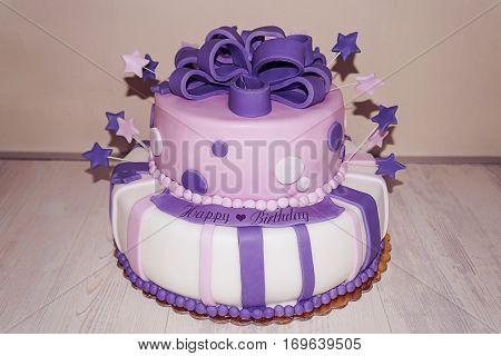 Pink purple fondant birthday cake stars and bow
