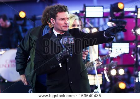 NEW YORK-DEC 31: Host Ryan Seacrest onstage during Dick Clark's New Year's Rockin' Eve at Times Square on December 31, 2015 in New York City.