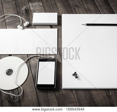 Blank corporate identity. Photo of blank stationery set on wooden table background. Mockup for branding identity. ID template. Responsive design mock up.