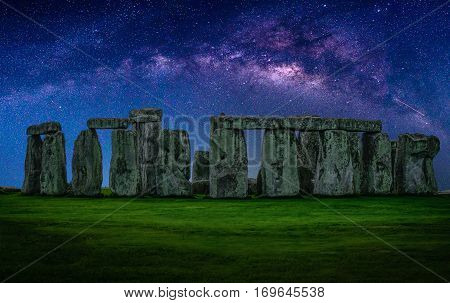 Landscape image of Milky way galaxy at night sky with stars over Stonehenge an ancient prehistoric stone monument Wiltshire UK.