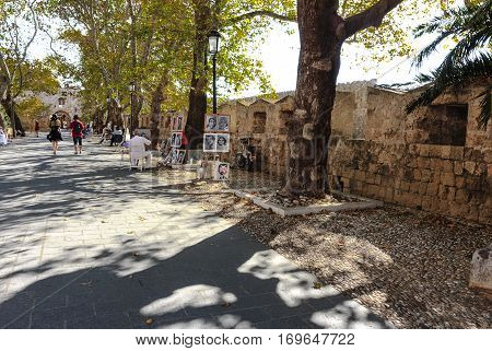 RHODES, GREECE-SEPTEMBER 23, 2016: A shady alley. Entrance to the old town in Rhodes Town, Greece