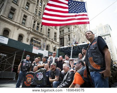 NEW YORK - SEPT 11 2016: Bikers from Raging Knights Fire Fighter MC and various motorcycle clubs walk in Lower Manhattan to pay respect for the annual Honor Ride commemorating the 9/11 terror attacks.