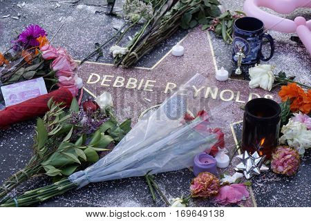 LOS ANGELES - DEC 29: Fans pay tribute to actress Debbie Reynolds at her star on the Hollywood Walk of Fame on December 29, 2016 in Los Angeles, California