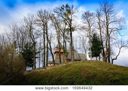 Very old gothic wooden medieval gothic catholic church in Grywald Pieniny Mountains in Poland