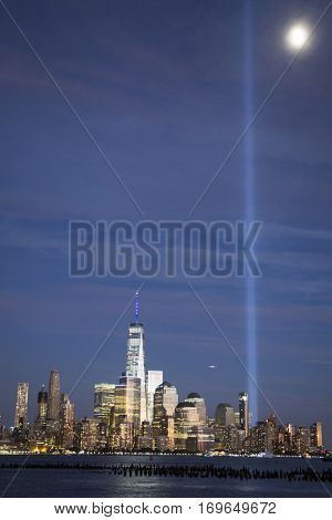 HOBOKEN, NJ - SEPT 11 2016: Tribute in Light, twin blue beams by Municipal Art Society of New York shine from Lower Manhattan on the 15th anniversary of the terror attacks at the World Trade Center.