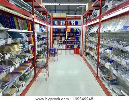 READING - DECEMBER 29: Office administration products stacked in an aisle of Staples Reading on December 29, 2016 in Reading, Berkshire, UK.