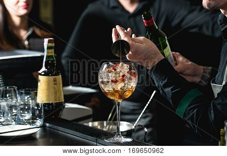 Bartender Making Refreshing Coctail With Strawberries Isolated On A Bar Background