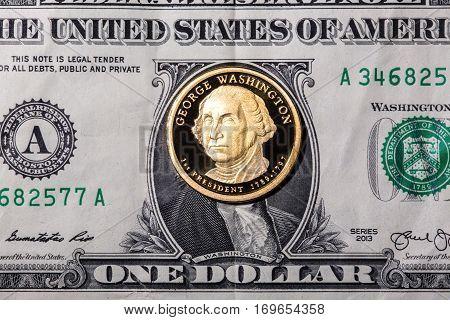 One dollar coin - George Washington - on one dollar banknote. Closeup, macro shot