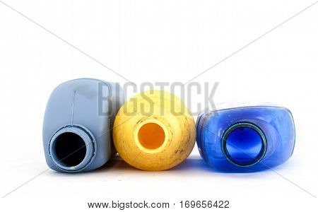 image of a Used plastic bottles for chemicals on white background