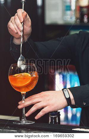 bartender makimg orange margareta fresh Cocktail in bar