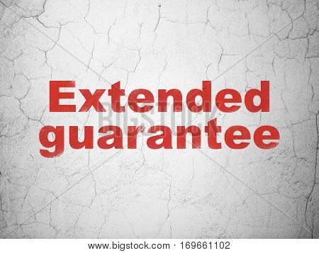 Insurance concept: Red Extended Guarantee on textured concrete wall background