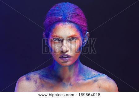Portrait of beautiful young woman with amazing body-art