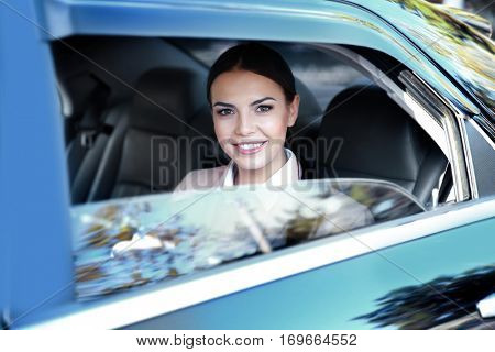 Businesswoman in luxury car, closeup