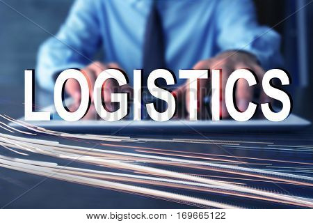 Logistics concept. Man with tablet and blurred traffic lights
