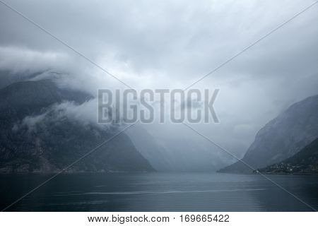 Norwegian landscape with Eidfjord, branch of the Hardangerfjord,  the fourth longest fjord in the world and the second longest fjord in Norway