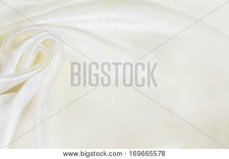 Closeup of white silk drapery for background
