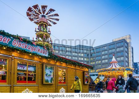 BERLIN, GERMANY - DECEMBER 23, 2016: Decorated booths and christmas lights at Alexanderplatz Christmas Market.