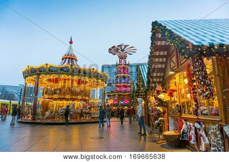 BERLIN, GERMANY - DECEMBER 23, 2016:Decorated booths and christmas lights at Alexanderplatz Christmas Market.