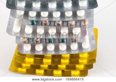 Different Medicines. Tablets, Pills In Blister Pack. Medications Drugs. Pills Over A White Backgroun