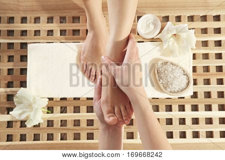 Foot massage in spa salon, closeup