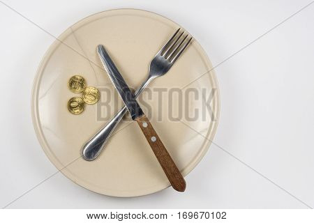An Empty Cracked Plate With Knife And Fork, It Is Based On Three Ten-coin