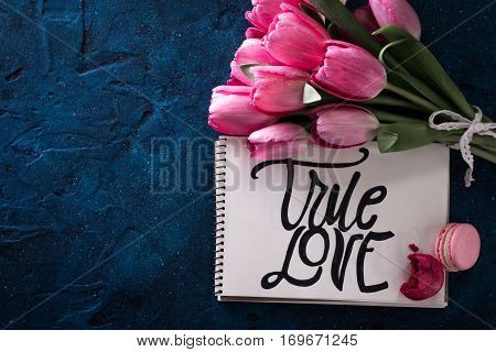 Fresh Pink Tulip Flowers Bouquet . With Inscription True Love On Paper.