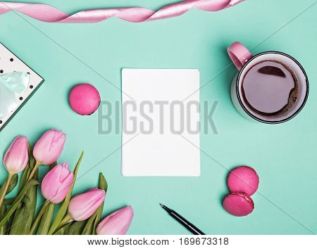 Blank Paper, Pink Tulips, Macarons And Coffee In A Mug