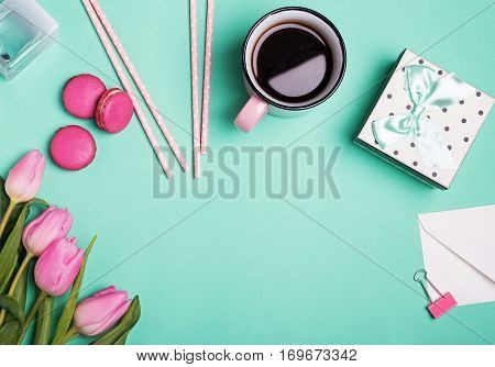 Feminine Accessories And Pink Tulips On Pastel Green Background.