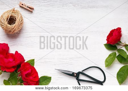 Red Roses, Jute Rope And Scissors On The Table, Top View