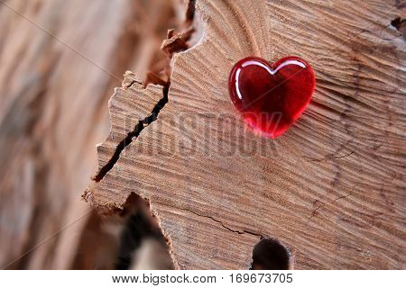 Red Glass Heart with soft focus wood background