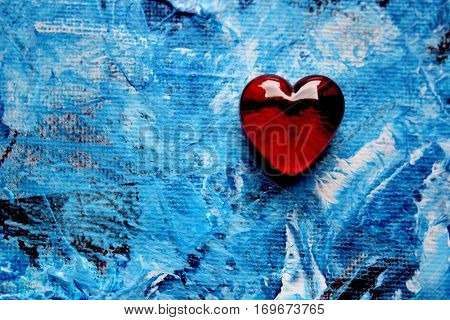 Red Glass Heart on Blue painted background