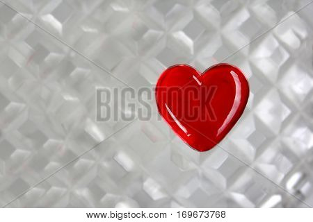 Red Glass Heart on crystal background