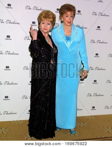LOS ANGELES -OCT 11:  Debbie Reynolds, Rhonda Fleming arrive at the Thalians Ball at the Century Plaza Hotel on October 11, 2003 in Century City, CA