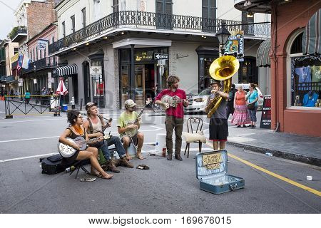 New Orleans Louisiana USA - June 17 2014: Street musicians playing in a street of the French Quarter in the city of New Orleans Louisiana.