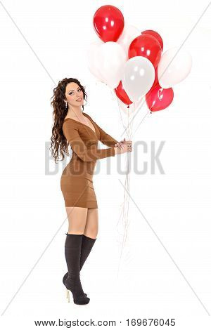 Beautiful young woman happily holding a gift