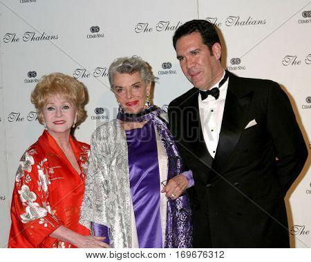 LOS ANGELES -NOV 7:  Debbie Reynolds, Jane Russell, Escort at the Thalians Ball at the Century Plaza Hotel on November 7, 2004 in Century City, CA