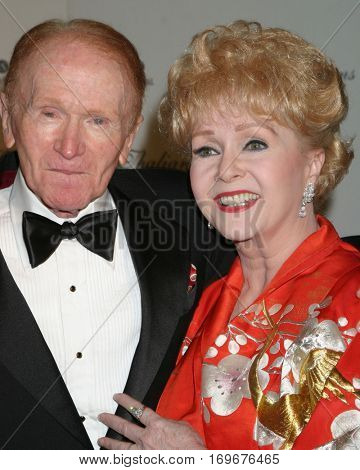 LOS ANGELES -NOV 7:  Red Buttons, Debbie Reynolds arrive at the Thalians Ball at the Century Plaza Hotel on November 7, 2004 in Century City, CA