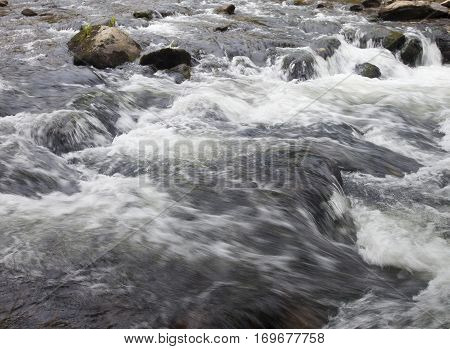 Water boiling over rocks on Wilson Creek in North Carolina