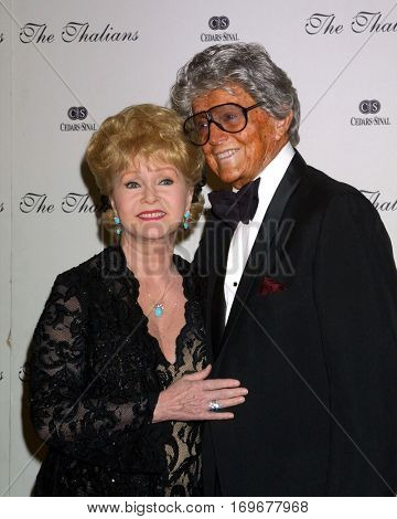 LOS ANGELES -OCT !!:  Debbie Reynolds, Gregg Juarez arrive at the Thalians Ball  at the Century Plaza Hotel on October 11, 2003 in Century City, CA