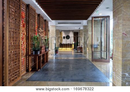 JIAXING, CHINA - FEBRUARY 21: Hotel lobby interior in Yuehe Hotel, Nanhu Qu, Jiaxing Shi, Zhejiang Sheng, on February 21, 2016 in Jiaxing, China.