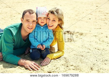 outdoor portrait of a family. young parents with a baby for a walk in the summer. Mom, dad and child