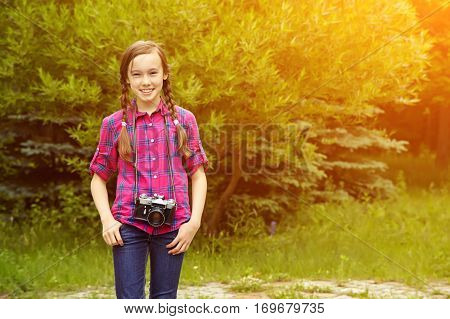 teenage girl with a camera. old photo camera. youth lifestyle
