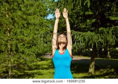 sporty athletic woman on a grass background. outdoor sports. healthy sport lifestyle. fitness, yoga