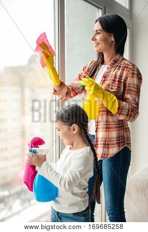 Mom And Daughter Cleaning House