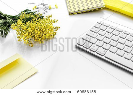 female desktop with keyboard and flowers close up no one