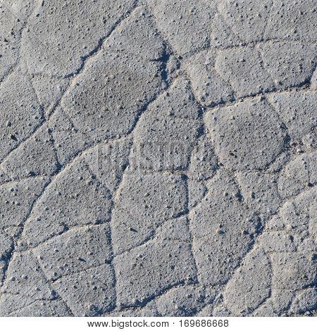 Old worn and cracked asphalt with cracks