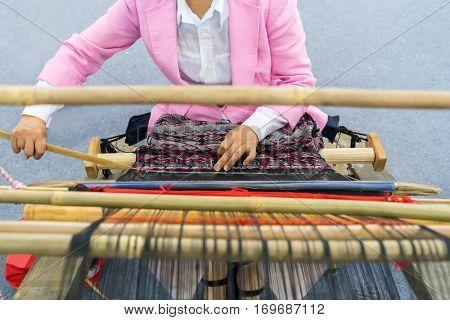 Women weaving a cloth in china