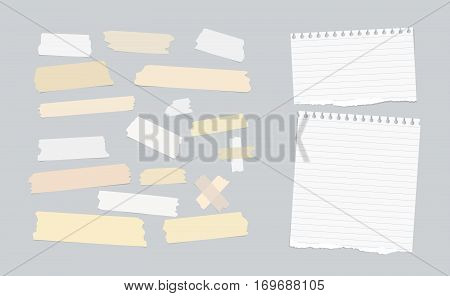 Sticky, adhesive masking tape, ripped note paper stuck on gray background.
