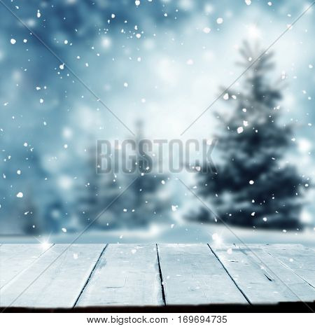 Merry christmas and happy new year greeting background with table .Winter landscape with snow and christmas trees.
